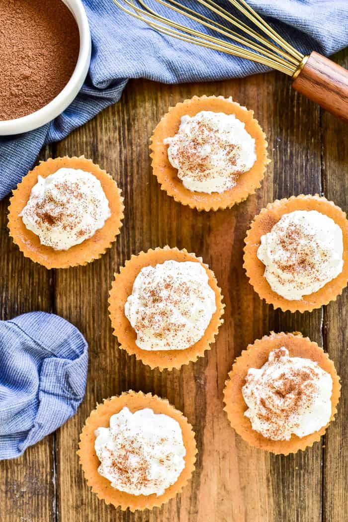 Mini Pumpkin Cheesecakes are the perfectdessert for any fall celebration! They combine all the flavors of pumpkin pie in a delicious bite-sized treat. These cheesecakes start with a sweet graham cracker crust and are filled with pumpkin cheesecake, whipped cream, and a sprinkle of cinnamon on top. And best of all, they combine two holiday favorites - pumpkin pie and cheesecake - in one awesome dessert that's sure to be a favorite!