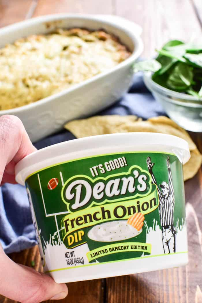 Hand holding container of Dean's French Onion Dip