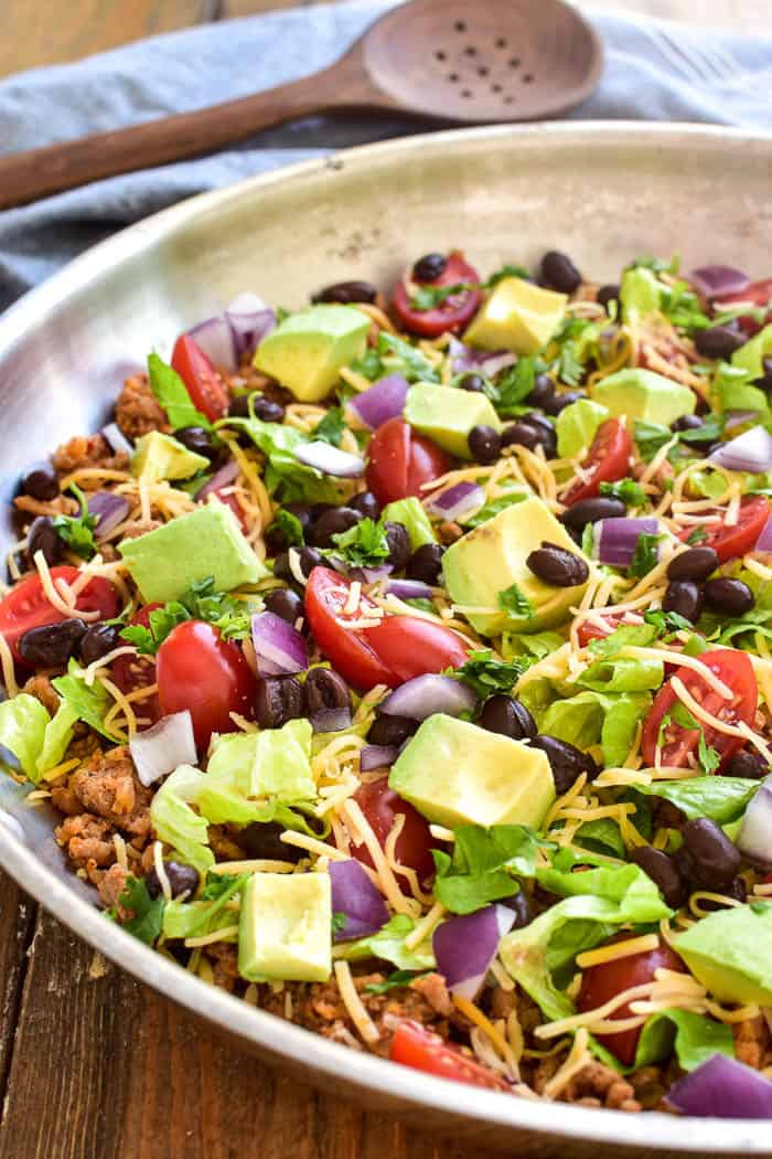 This Low Carb Taco Skillet is the ultimate healthy dinner recipe! Made with simple, fresh ingredients, this meal comes together quickly and is a delicious alternative to traditional tacos.