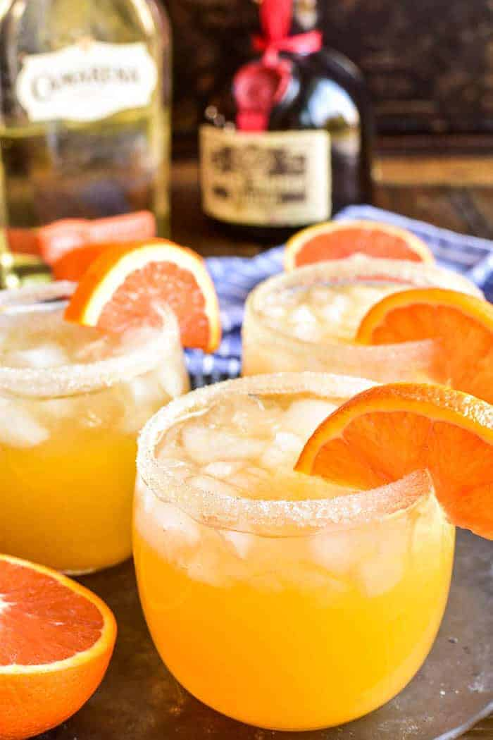 Orange Margaritas on serving tray with orange garnish