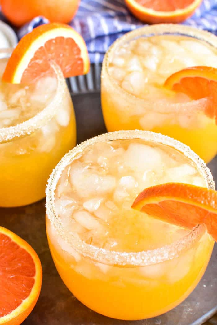 Top-down view of orange margaritas