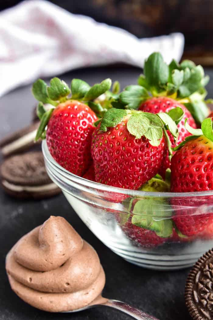 bowl of strawberries with spoonful of chocolate mousse