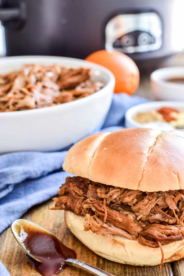 Honey Orange Pulled Pork in a bun with barbecue sauce