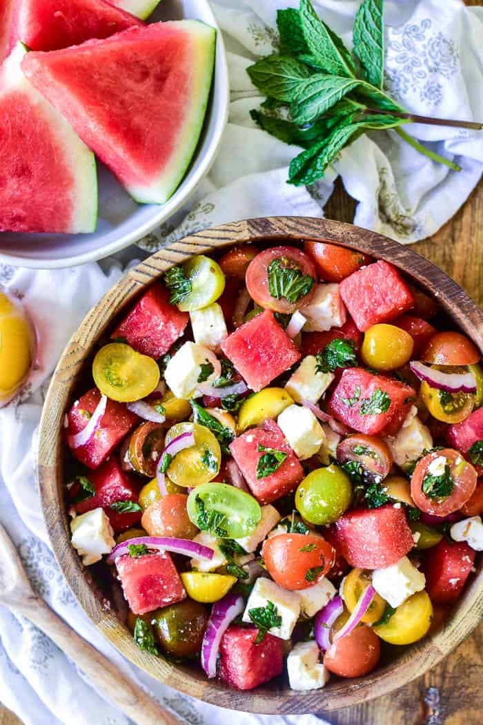 Watermelon Feta Salad with fresh ingredients in the background