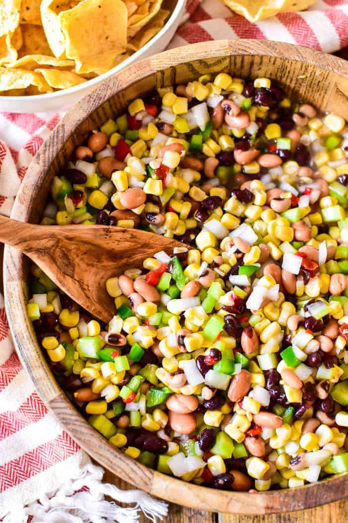 Cowboy Caviar with serving spoon in bowl