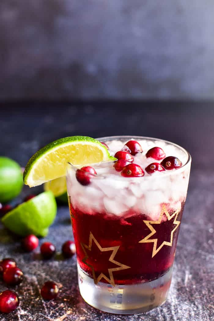 Vodka Cranberry with lime wedge and fresh cranberries