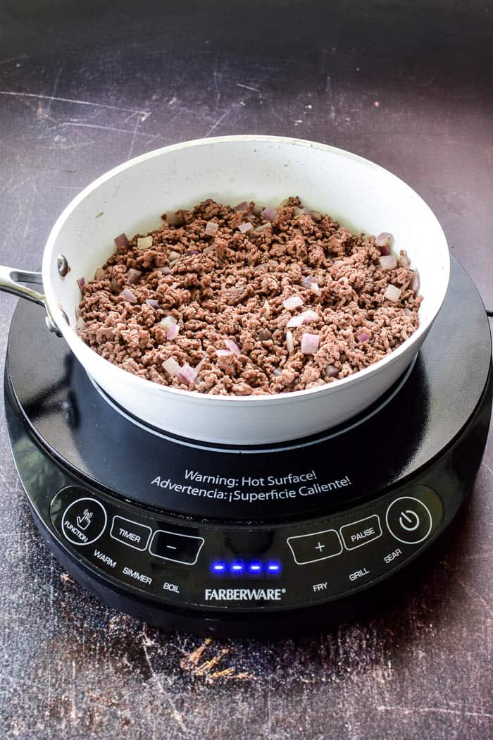 Ground beef & onions in skillet