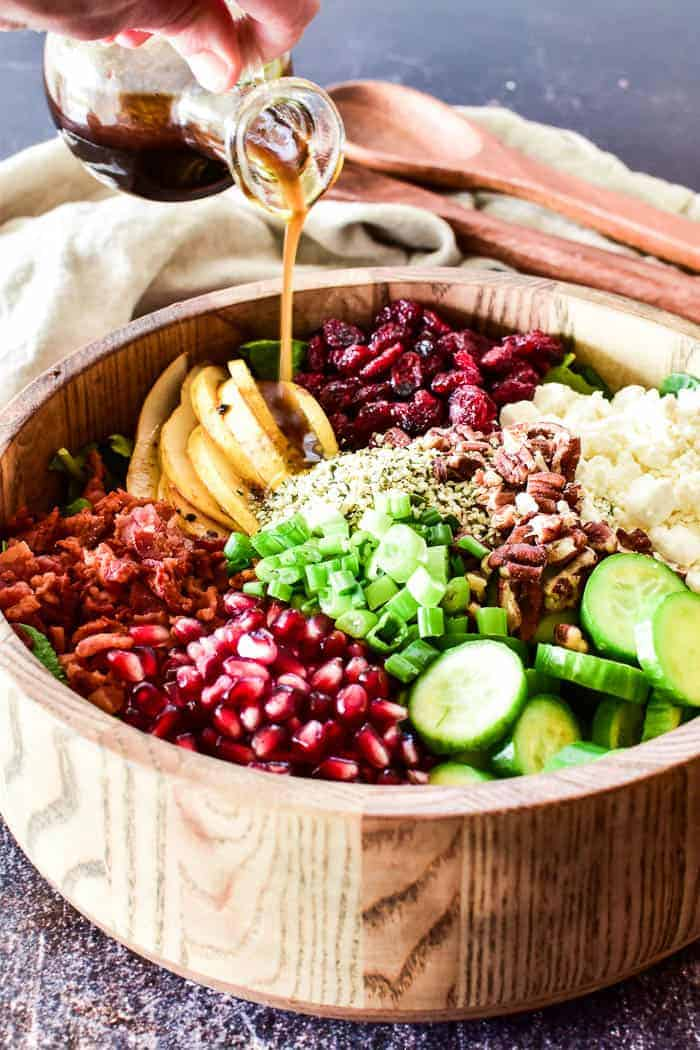 Pouring balsamic vinaigrette on Winter Salad