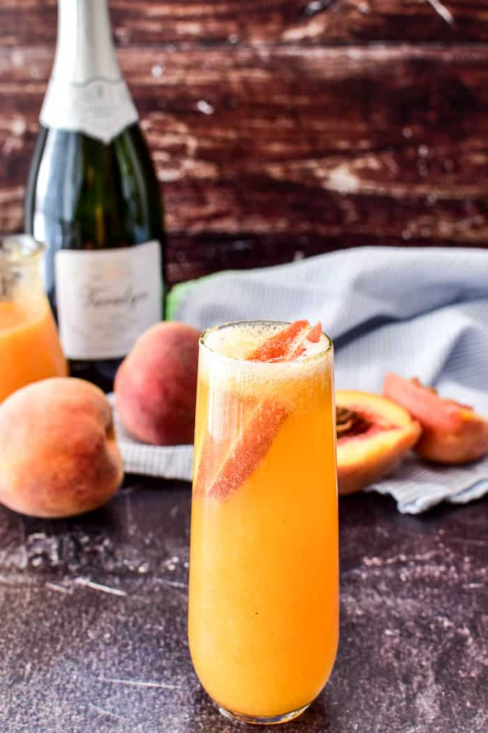 Bellini garnished with fresh peach slices