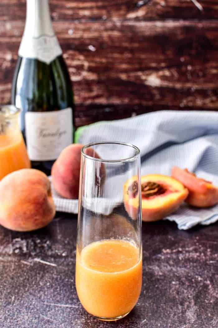 Peach puree in glass for bellini recipe