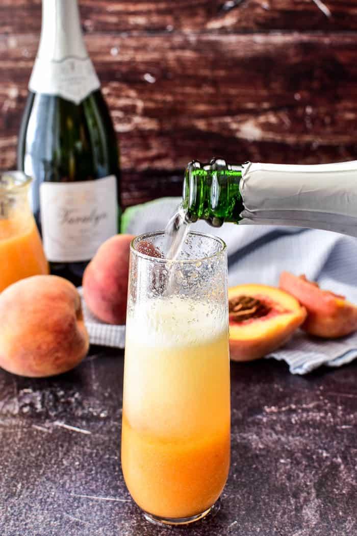 Champagne pour shot for bellini recipe