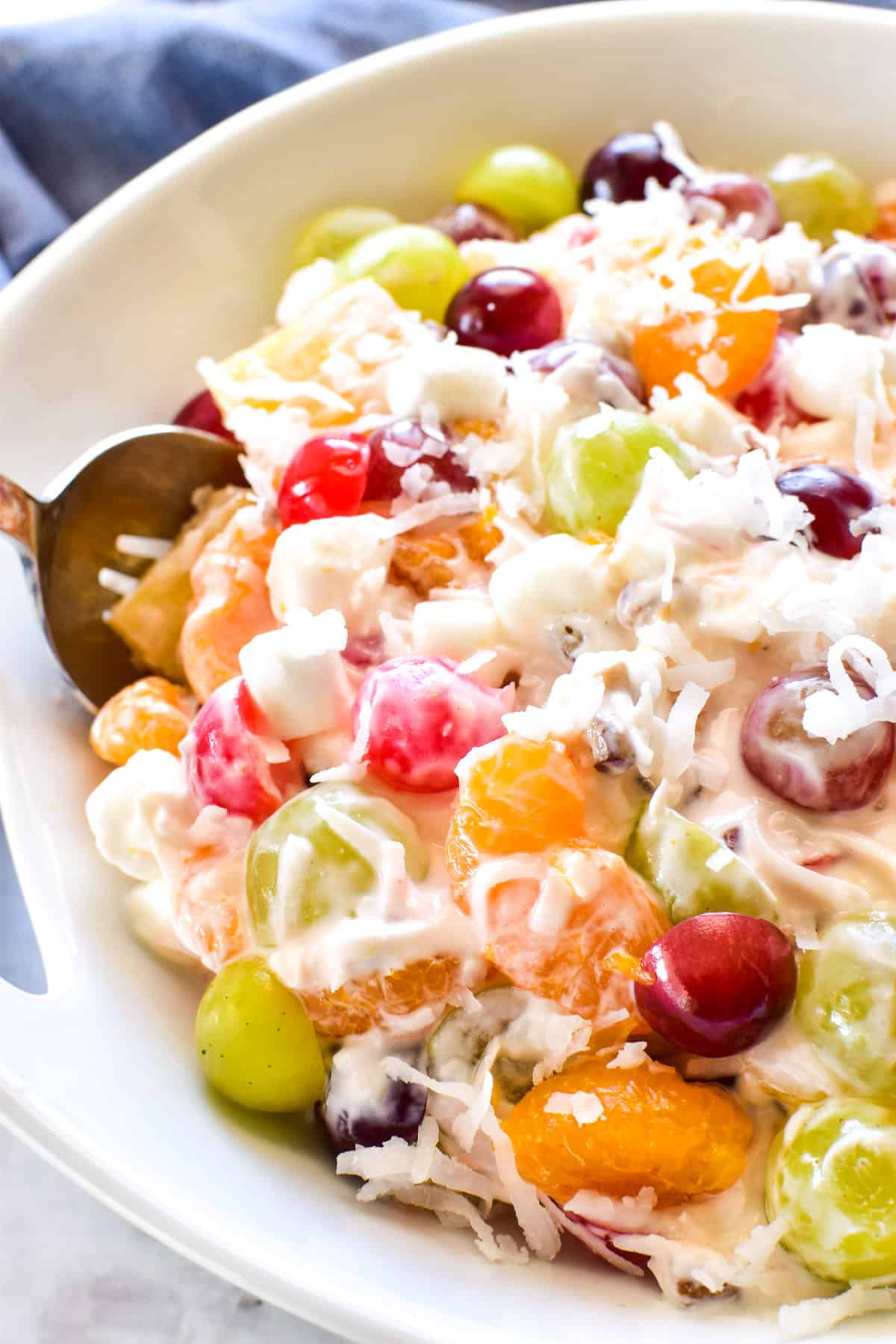 Ambrosia Salad in serving bowl with spoon