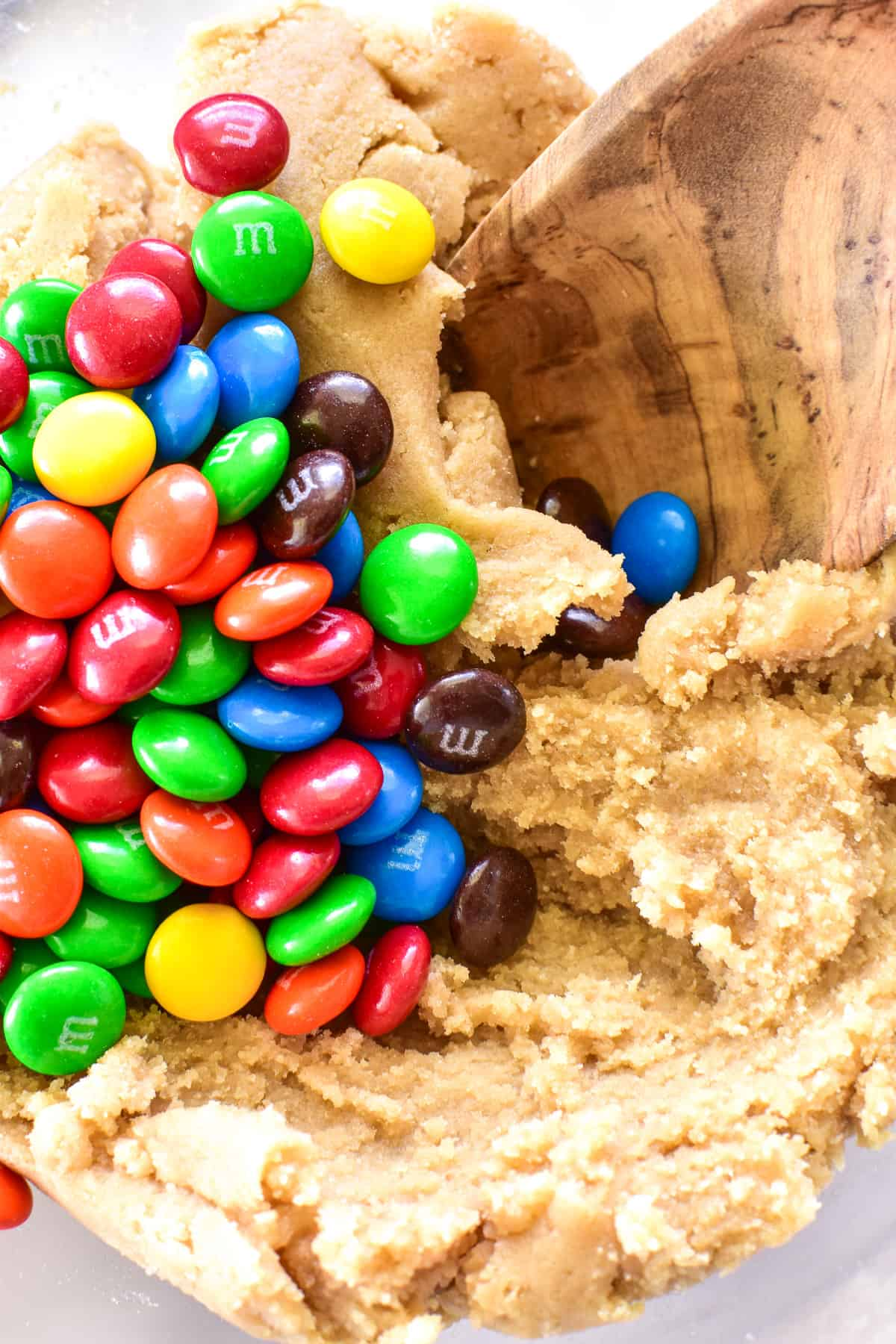 Cookie Dough with m&m's being stirred in