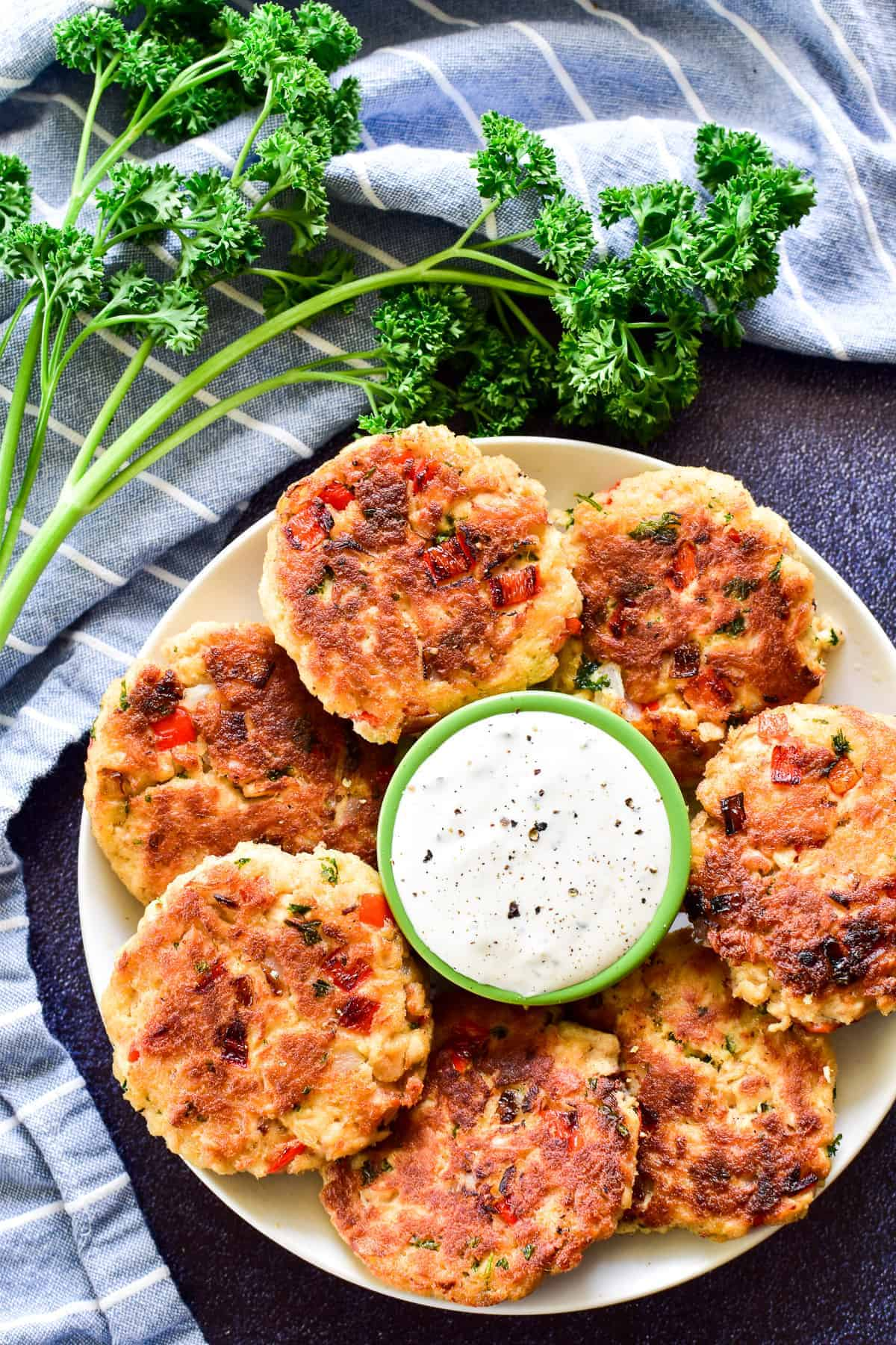 Overhead shot of Salmon Patties on plate with dipping sauce