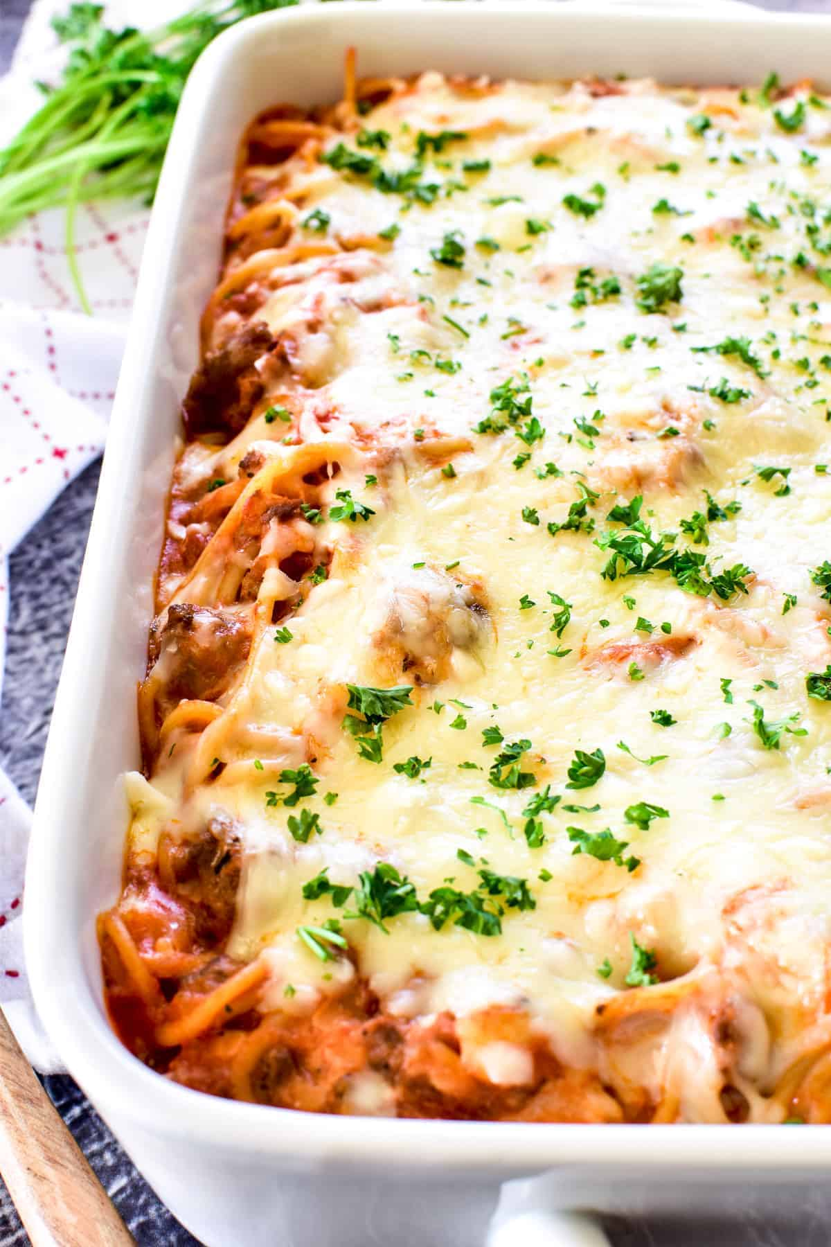 Baked Spaghetti in pan topped with fresh parsley