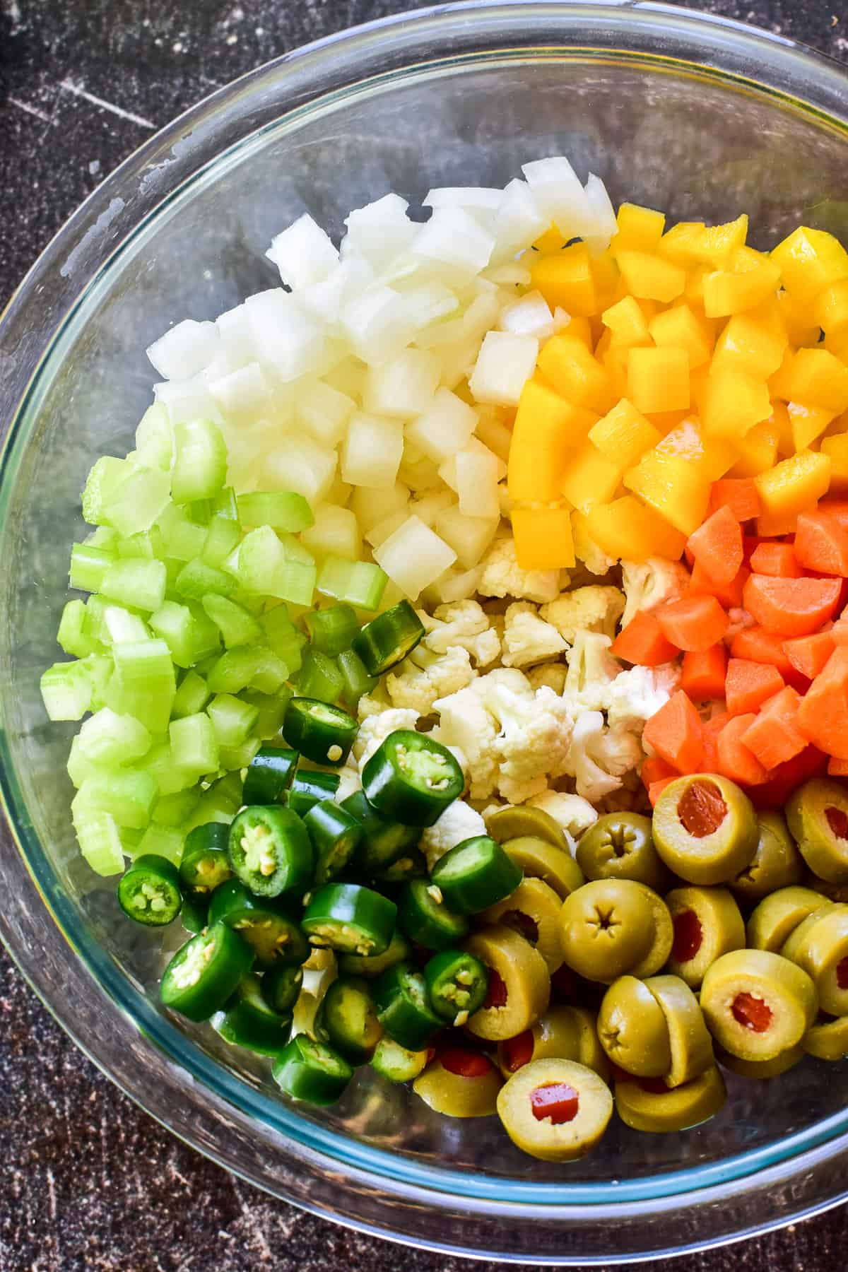 Chopped veggies in glass bowl