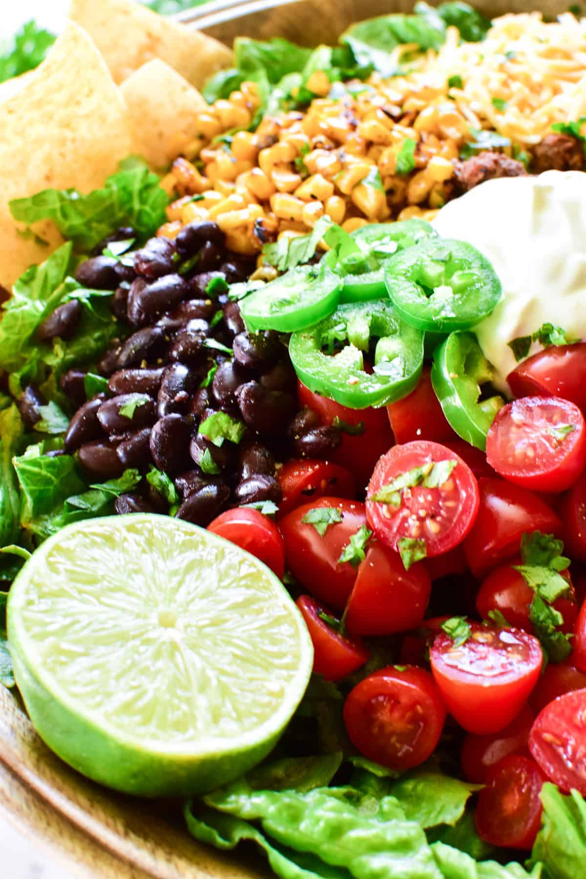 Taco Salad close up of tomatoes and lime