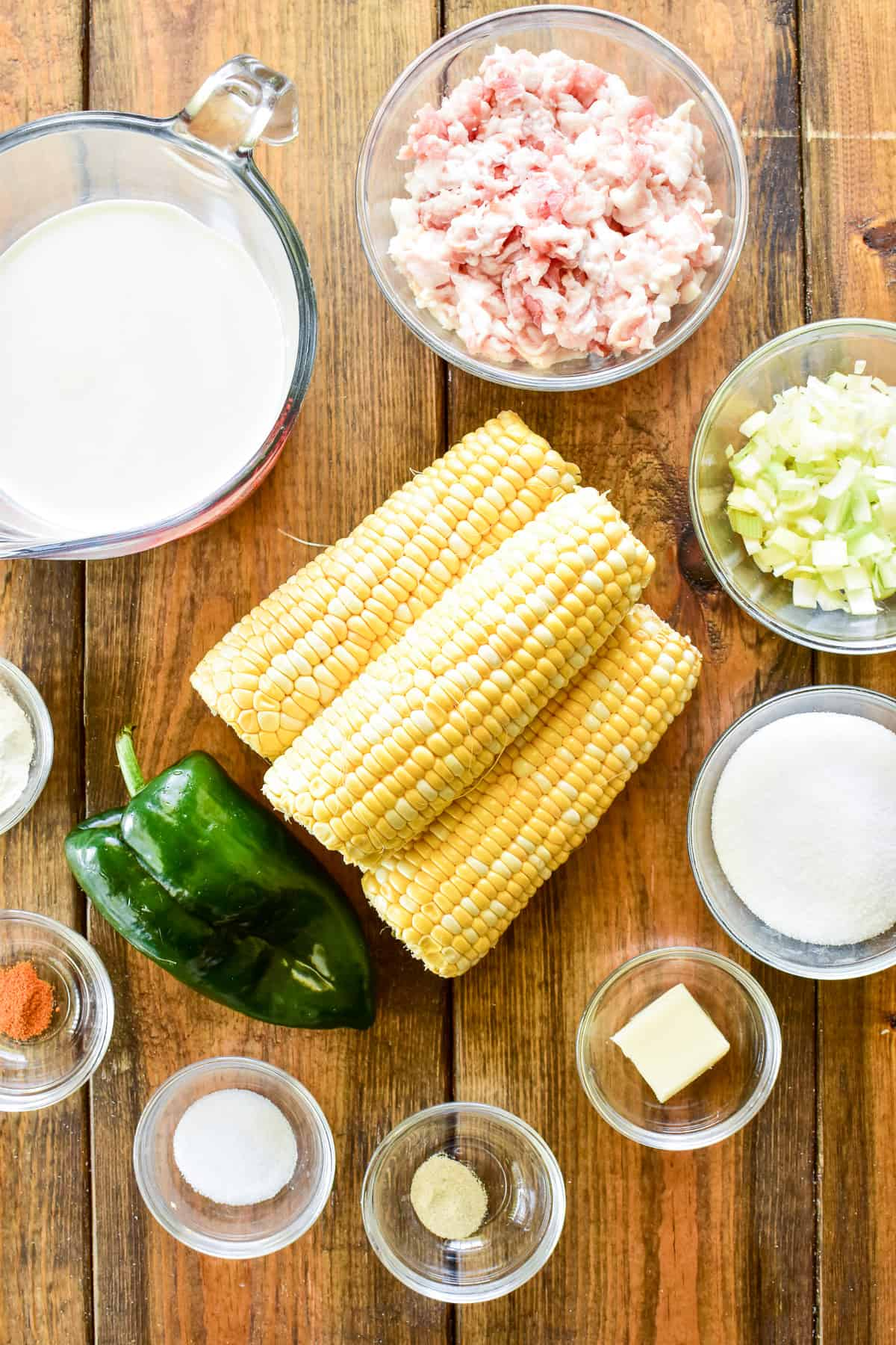 Creamed Corn ingredients on a wooden table