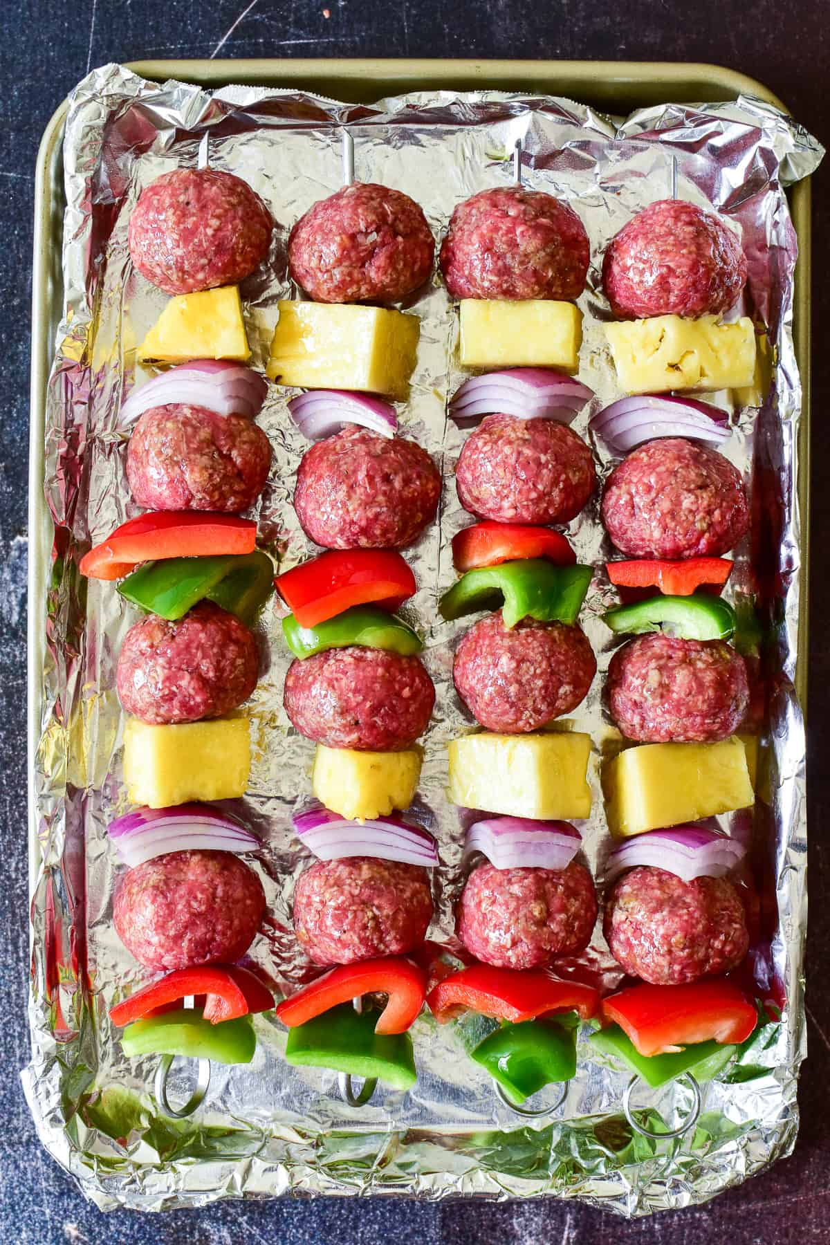 Overhead shot of Hawaiian Meatball Kabobs ready for the grill