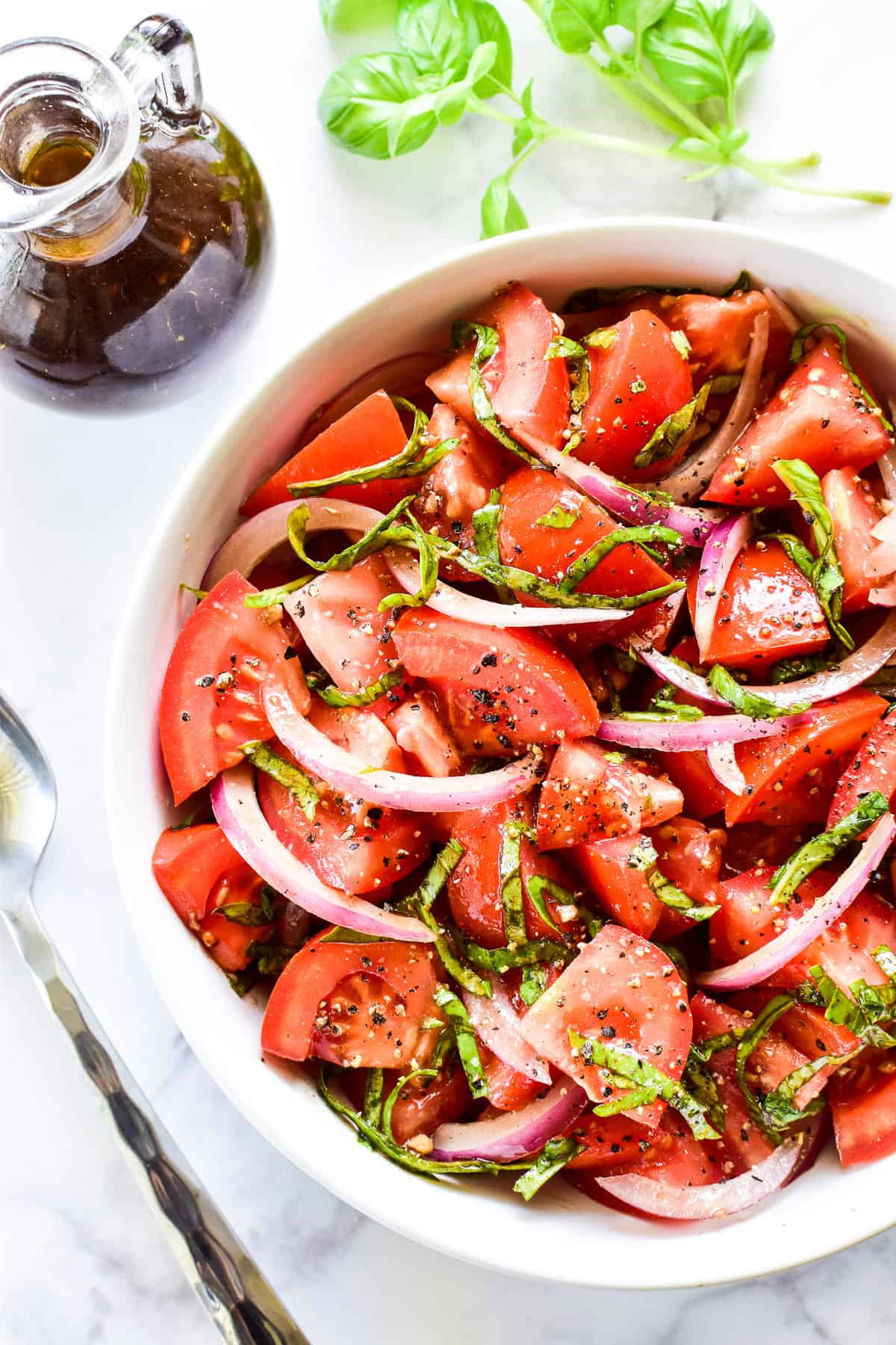 Overhead shot of Tomato Salad in a white bowl