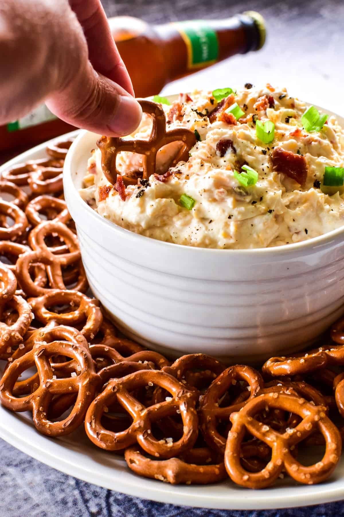 Pretzel dipping into Beer Cheese Dip