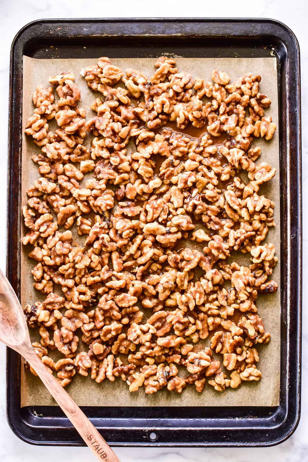 Overhead shot of Candied Walnuts on a baking pan