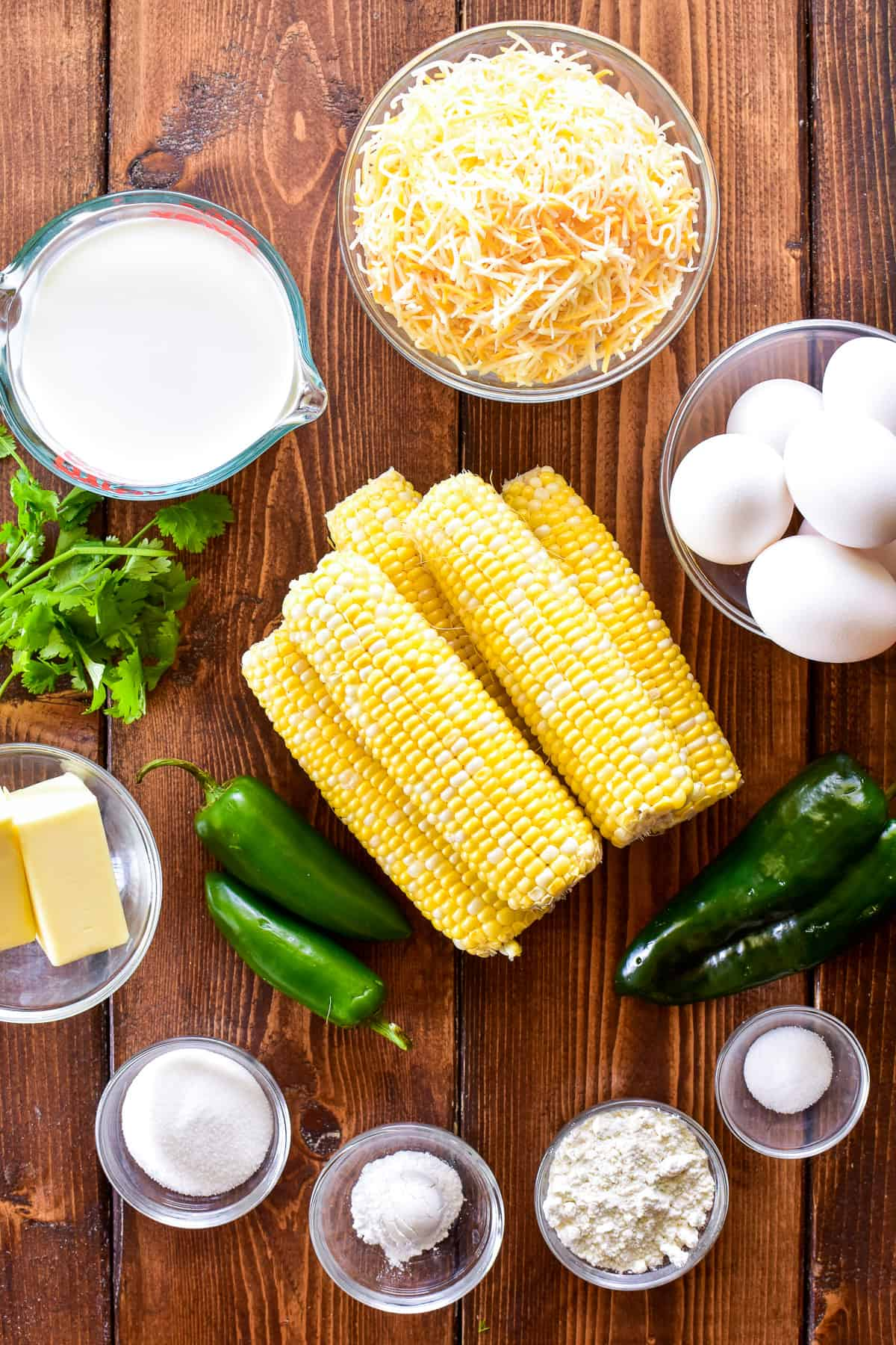 Corn Pudding ingredients on a wooden board