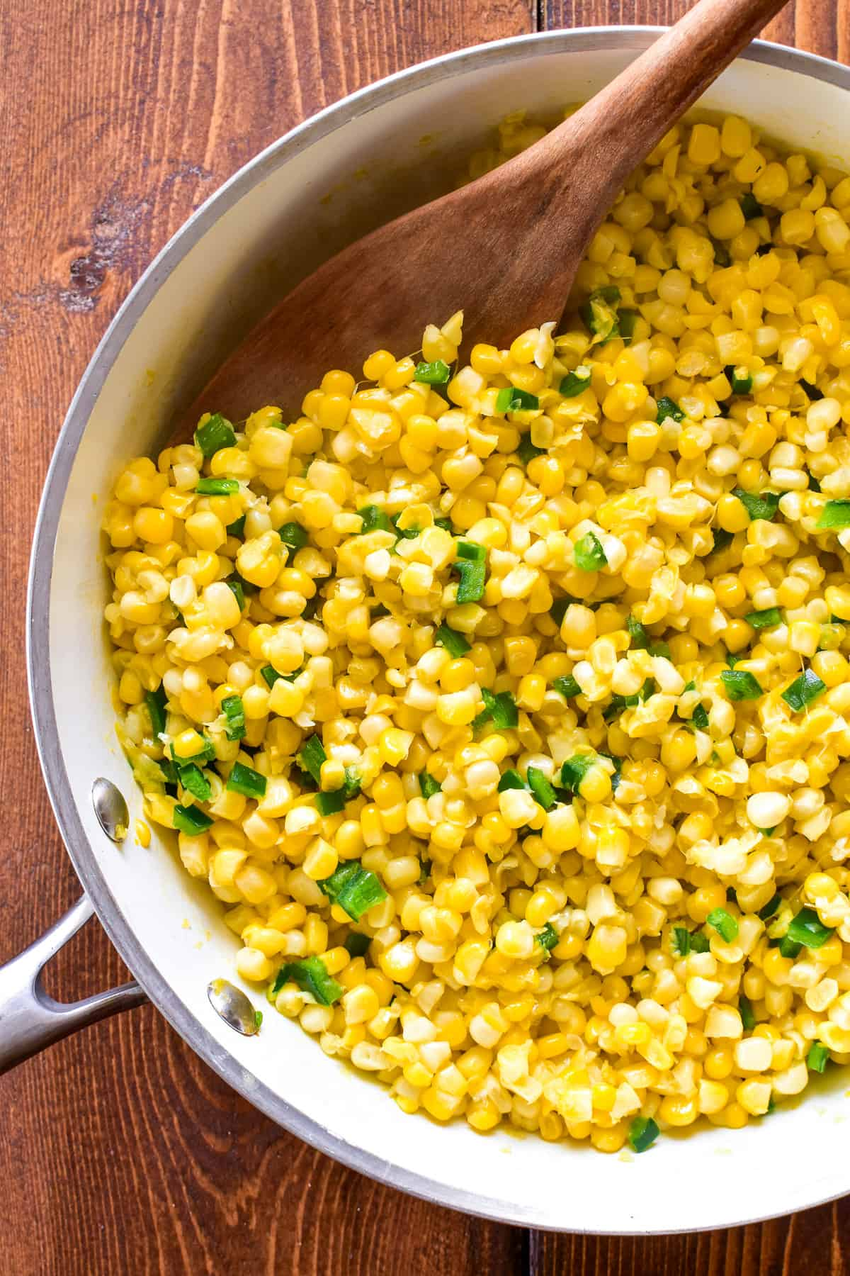 Corn and diced poblanos in a skillet