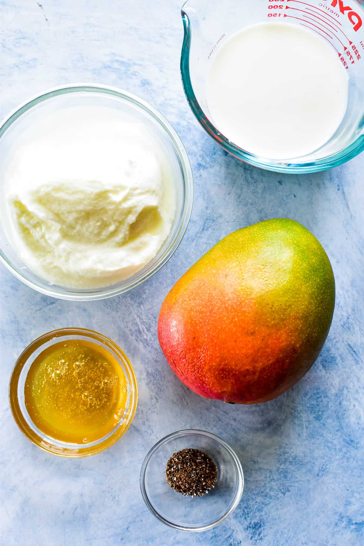 Mango Lassi ingredients on a blue background