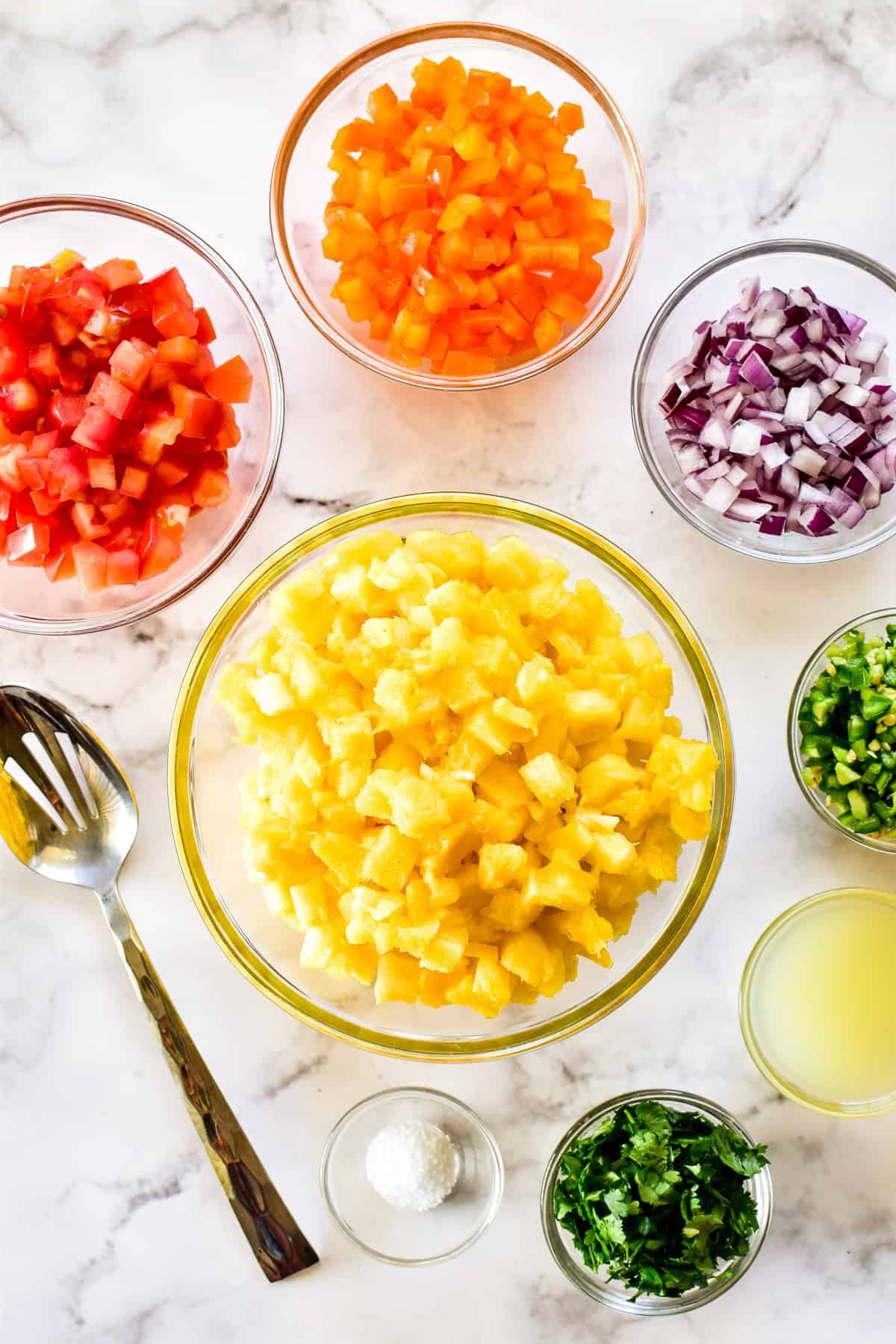 Pineapple Salsa ingredients chopped in glass bowls