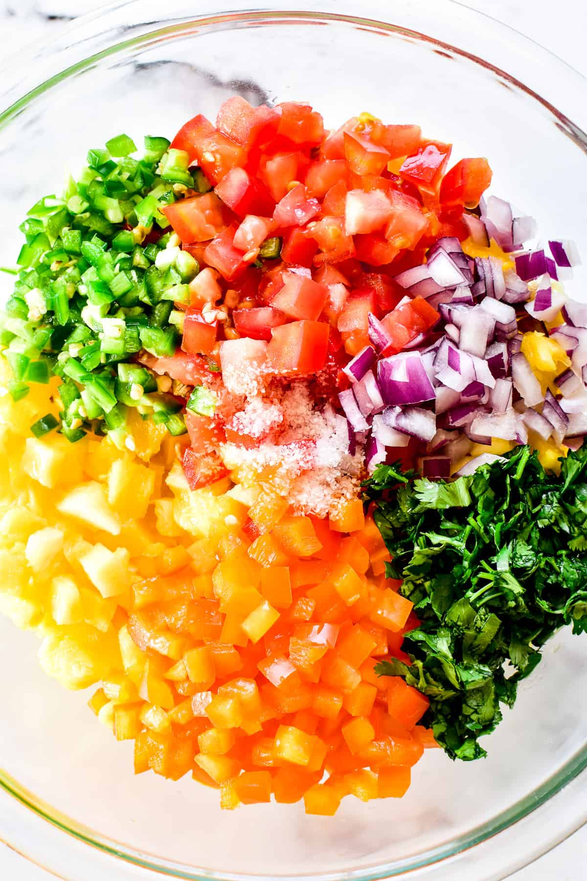 Pineapple Salsa ingredients layered in mixing bowl