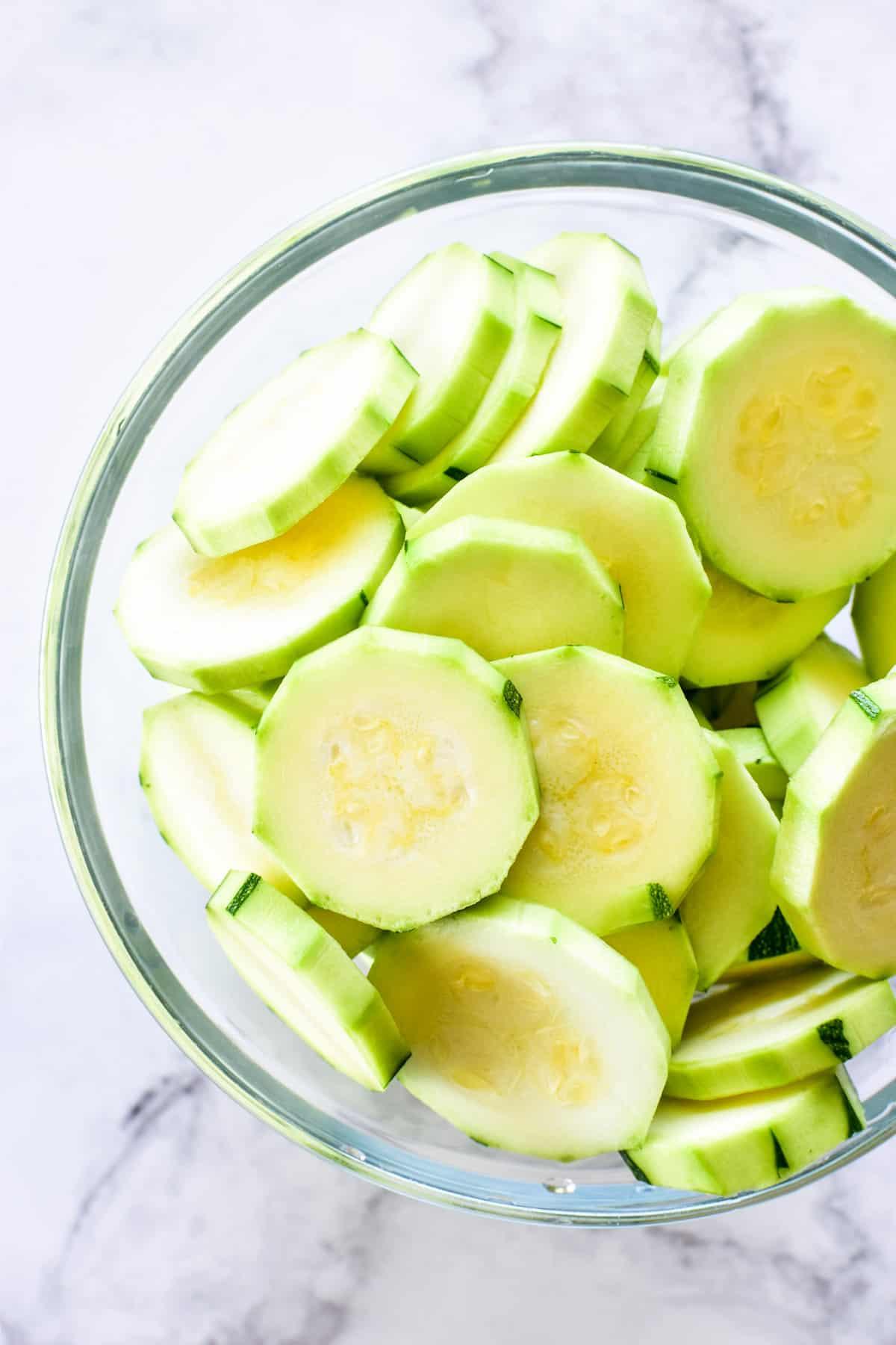 Sliced zucchini in a glass bowl