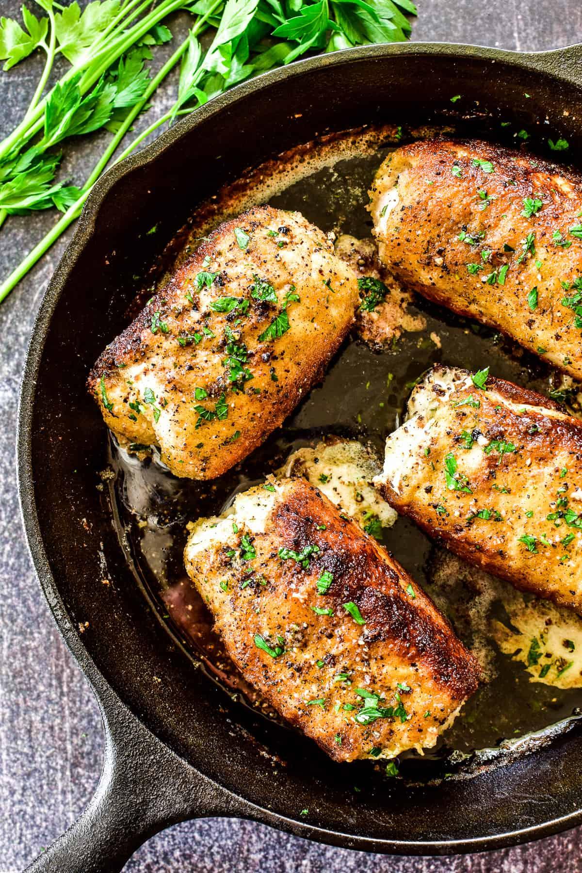 Overhead shot of Chicken Kiev in cast iron skillet