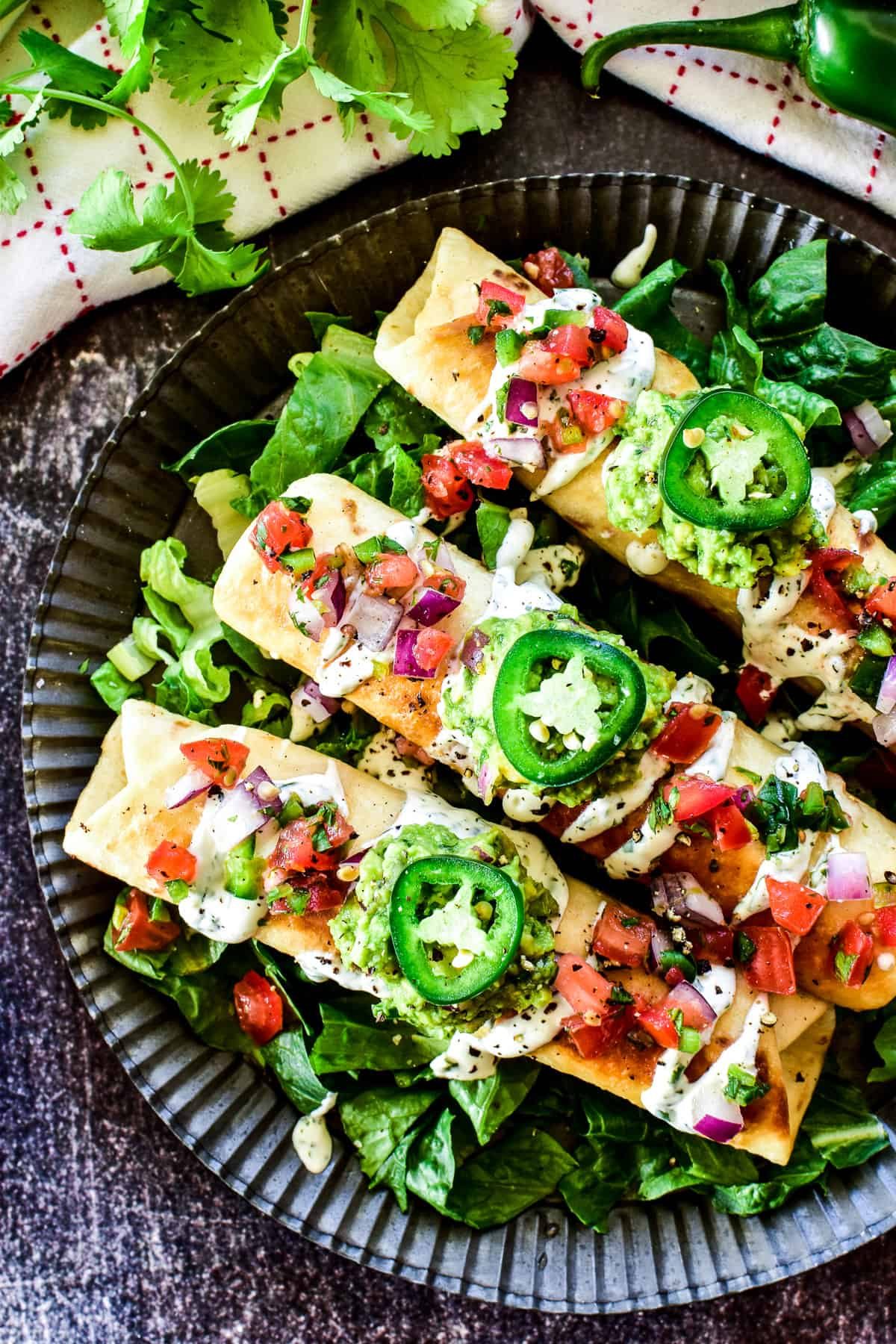 Overhead shot of Chicken Flautas with toppings
