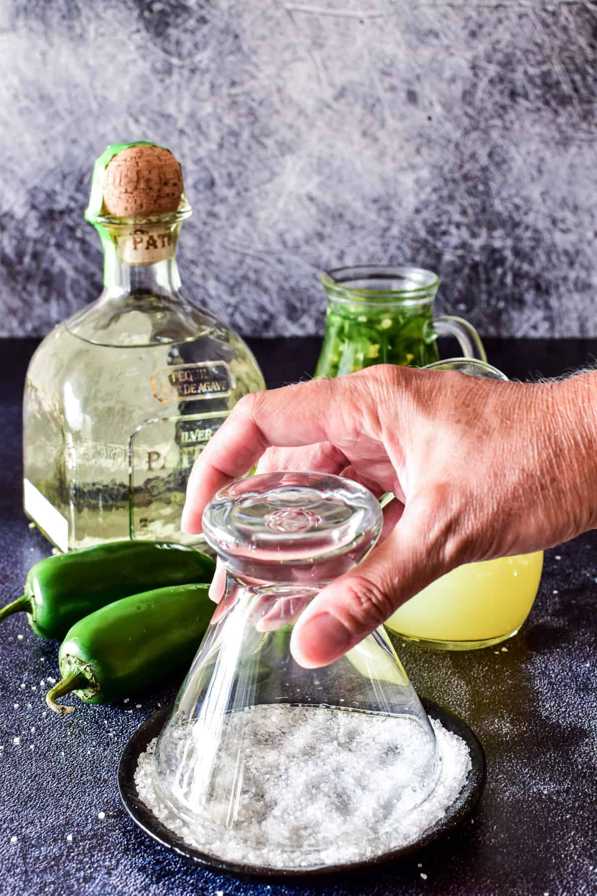 Dipping glass rim in salt