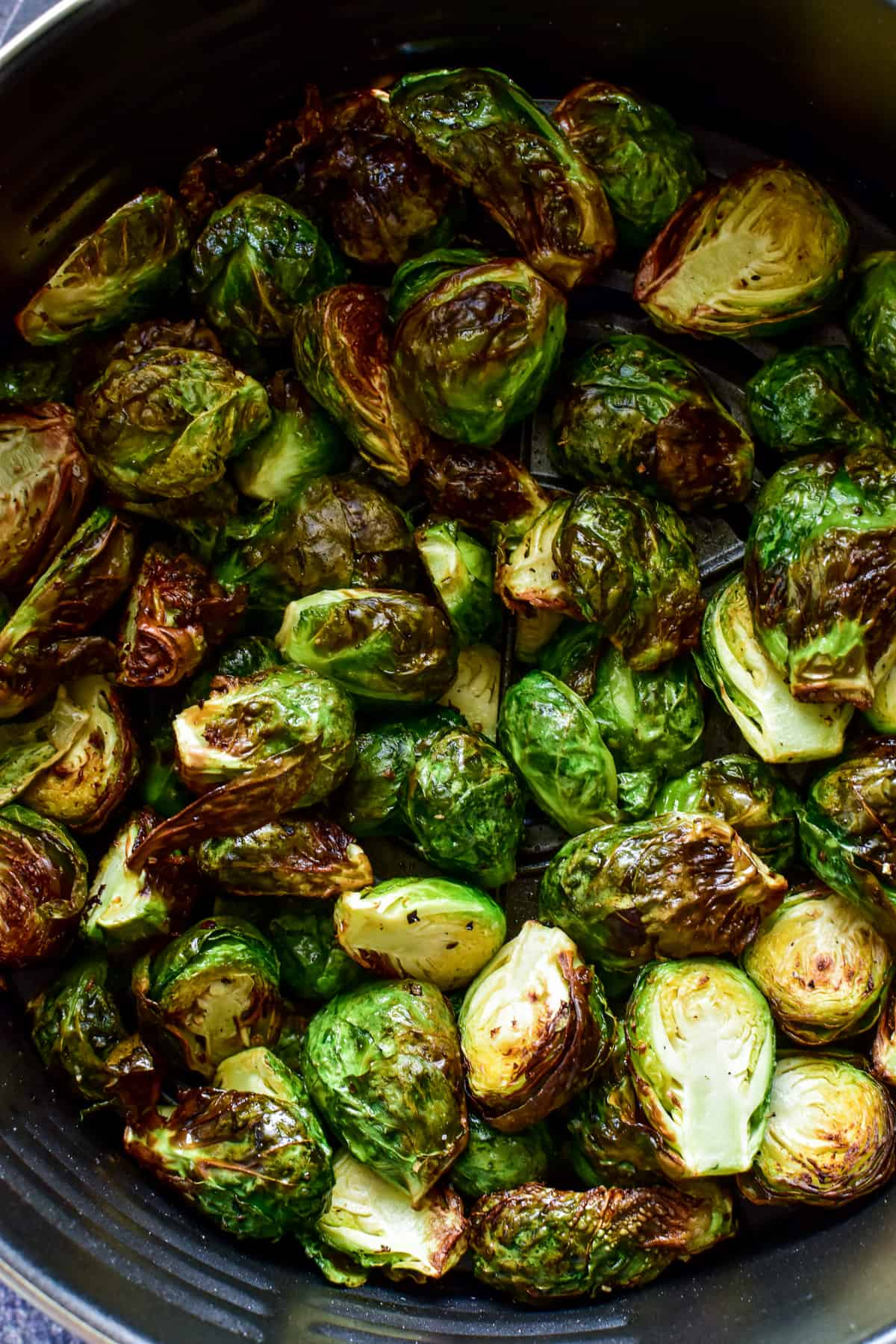 Brussels Sprouts in an air fryer basket