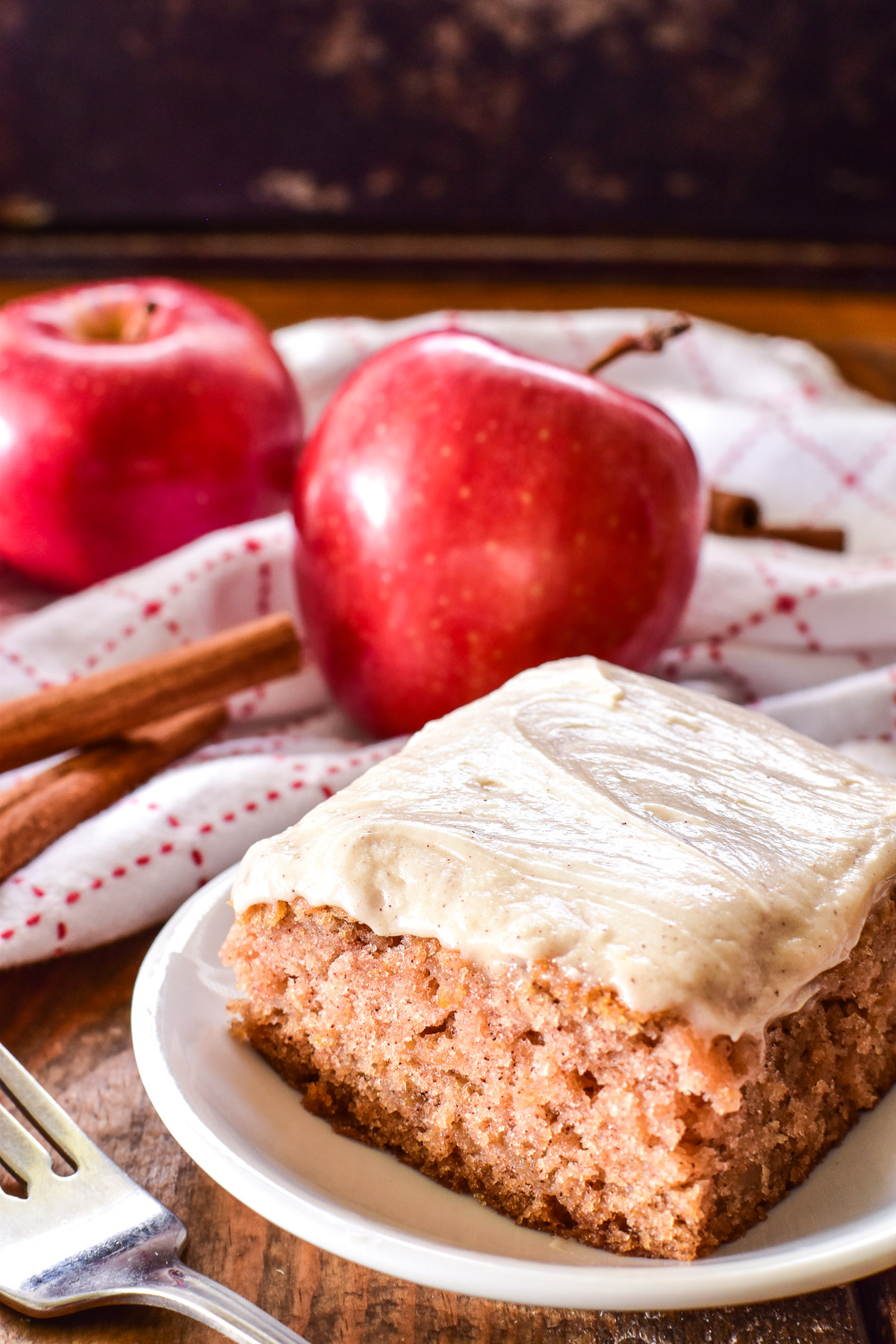 Side shot of Apple Cake on a white plate