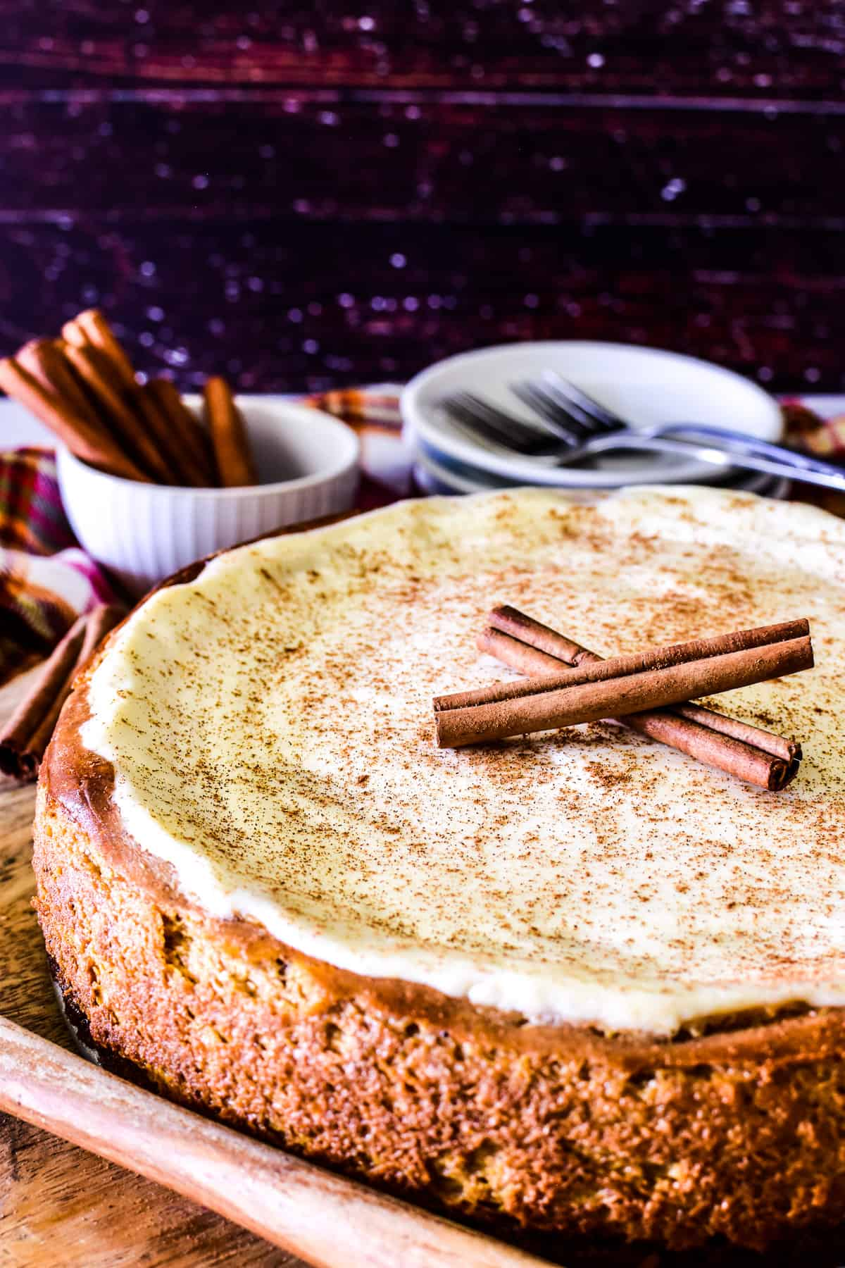 Whole Pumpkin Cheesecake with sour cream topping and cinnamon