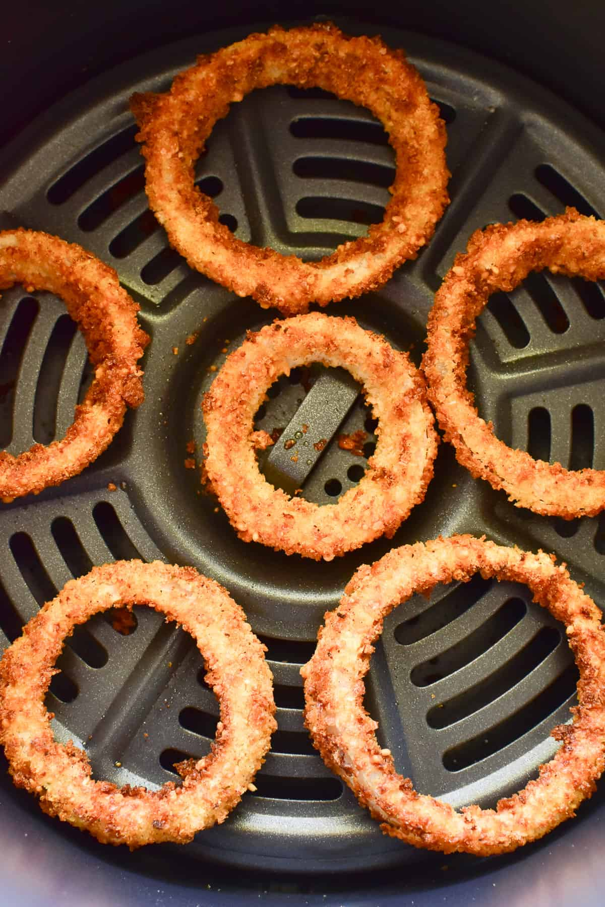 Onion Rings in an air fryer basket