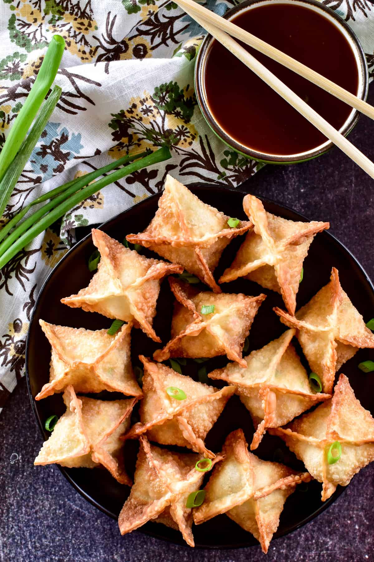 Overhead image of Crab Rangoon with floral towel
