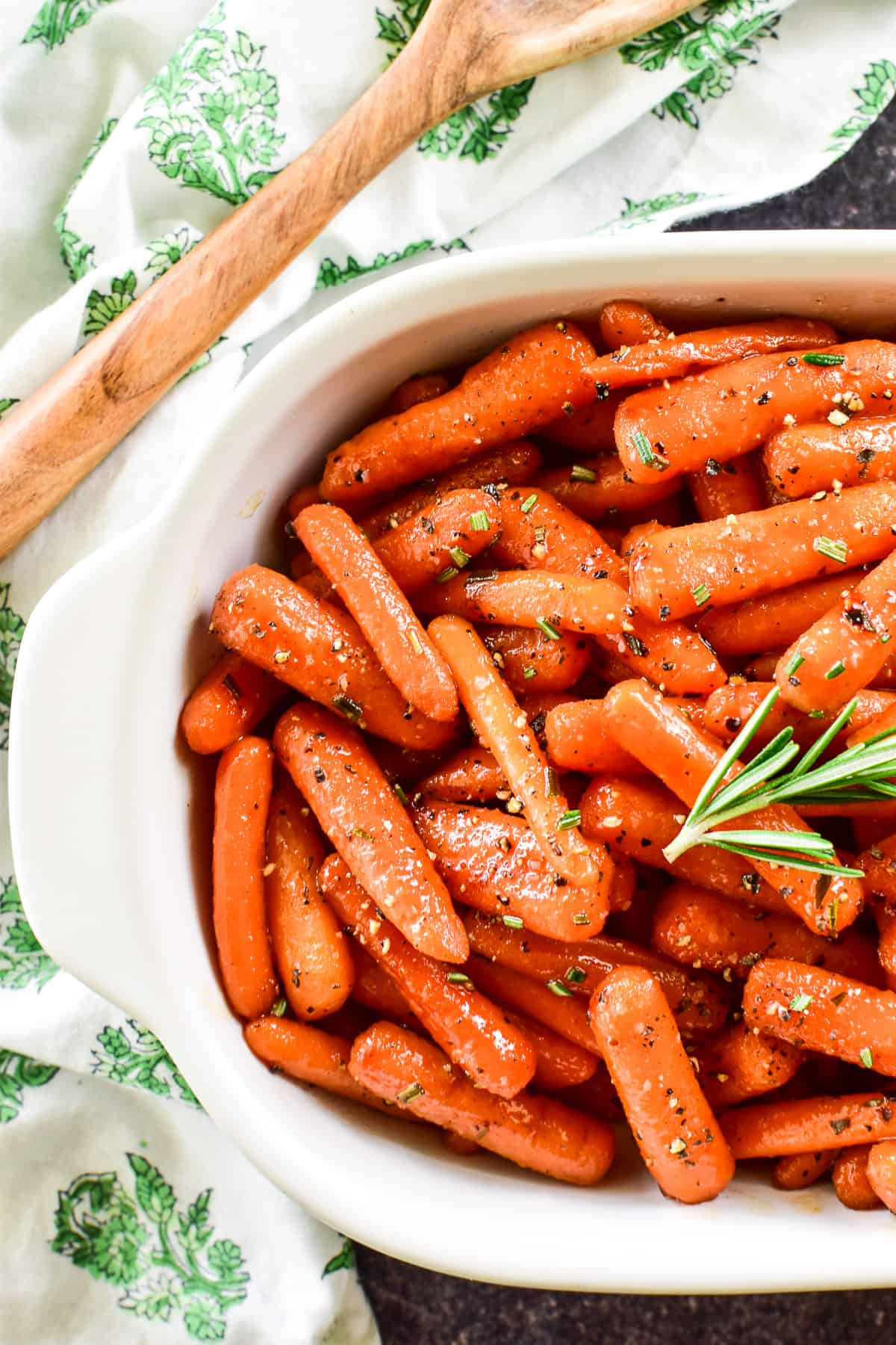 Overhead shot of Honey Glazed Carrots with fresh rosemary