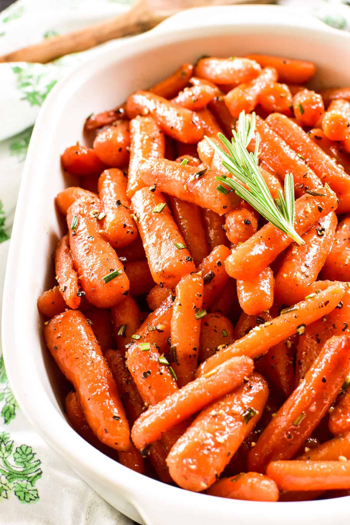 Finished shot of Honey Glazed Carrots in a white serving dish