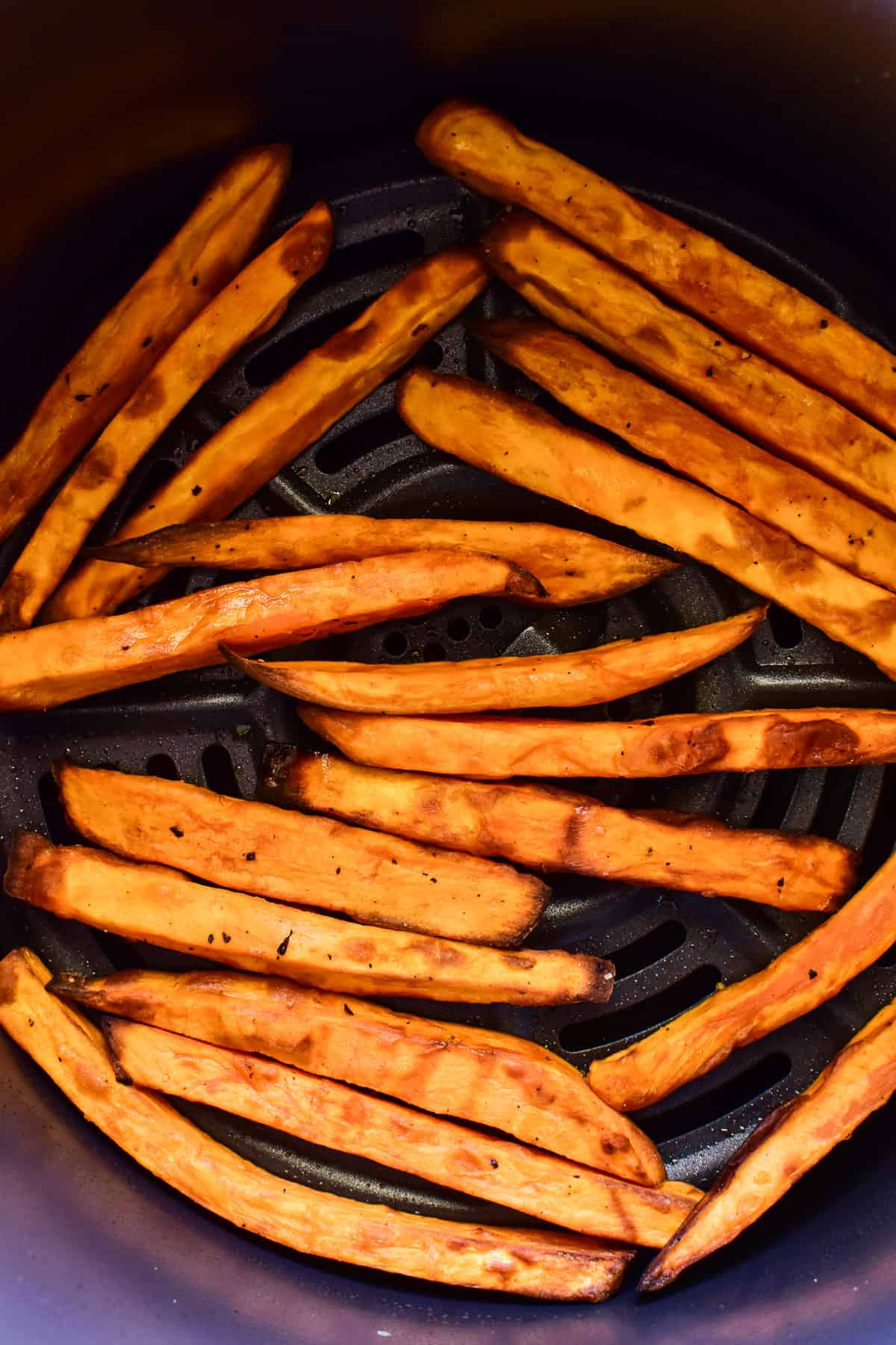 Sweet Potato Fries in an air fryer basket