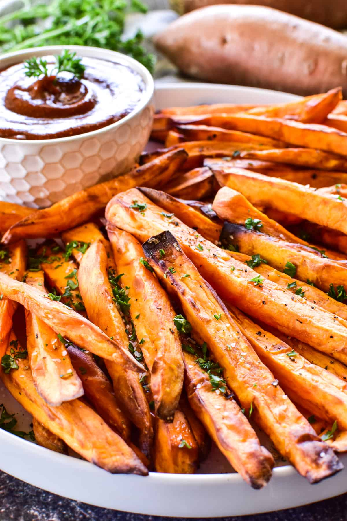 Side view of Sweet Potato Fries on a white plate