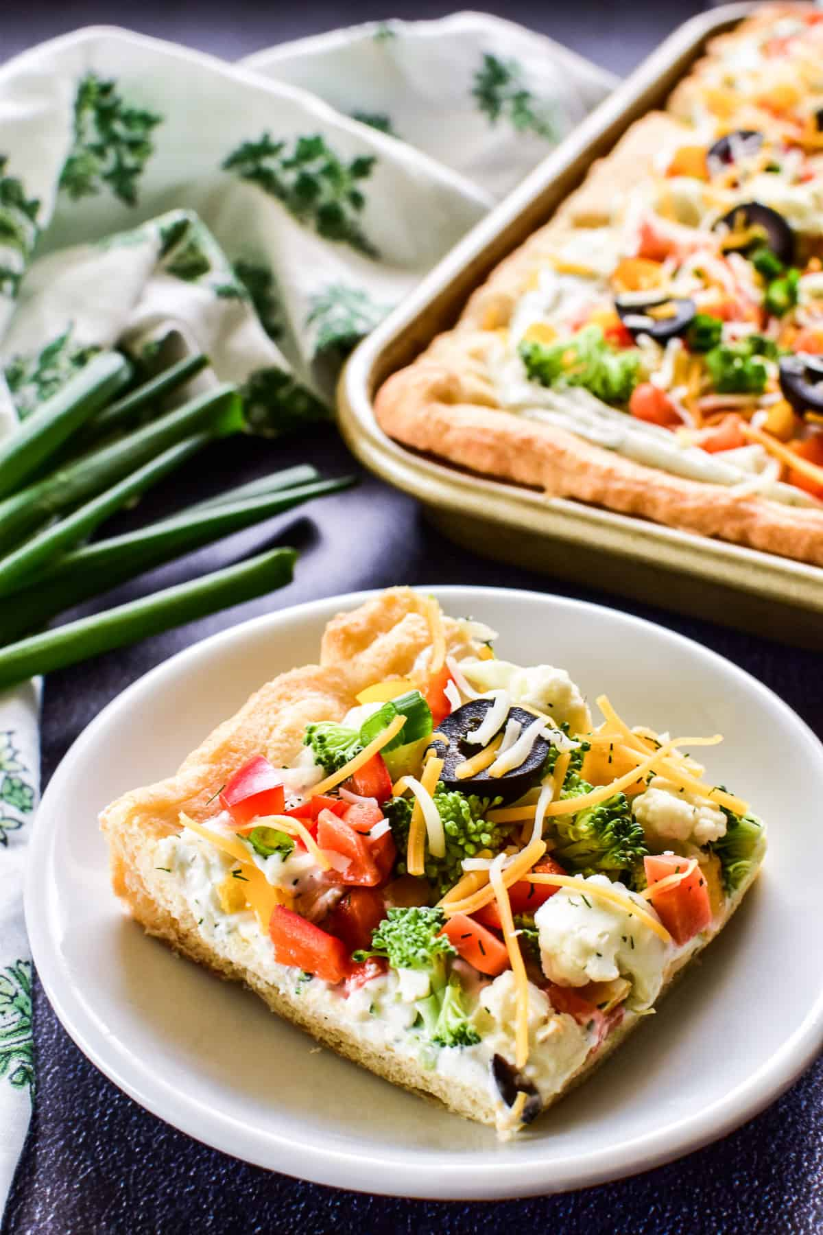 Veggie Pizza on a small white plate
