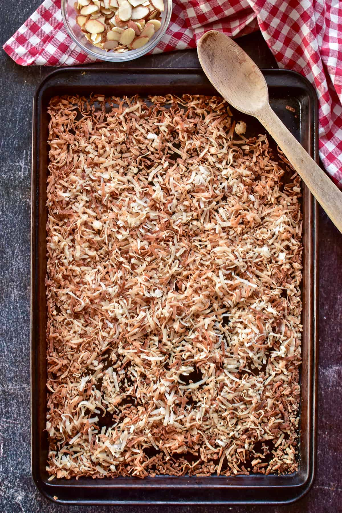 Overhead shot of toasted coconut on a baking pan