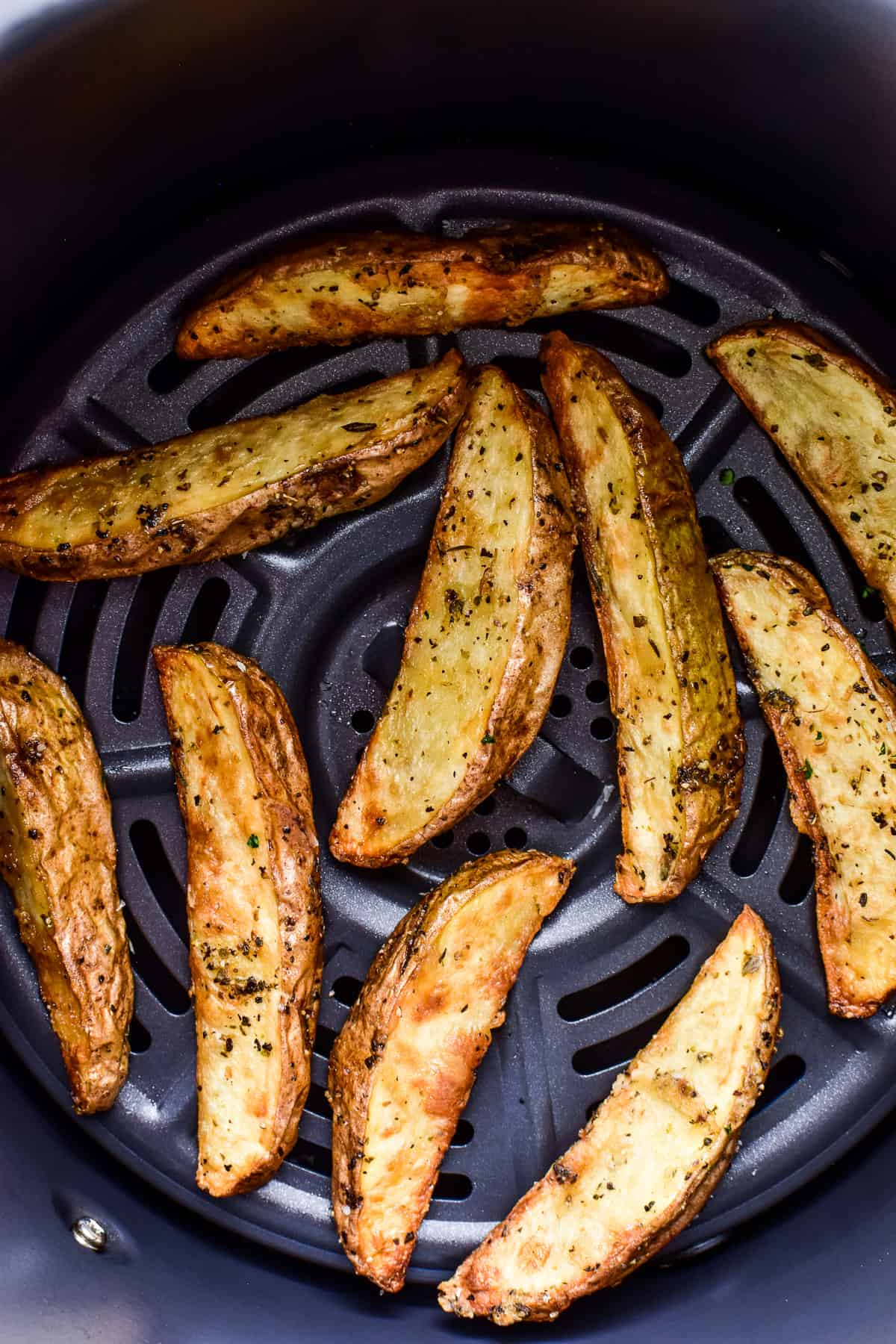 Potato Wedges in an air fryer basket