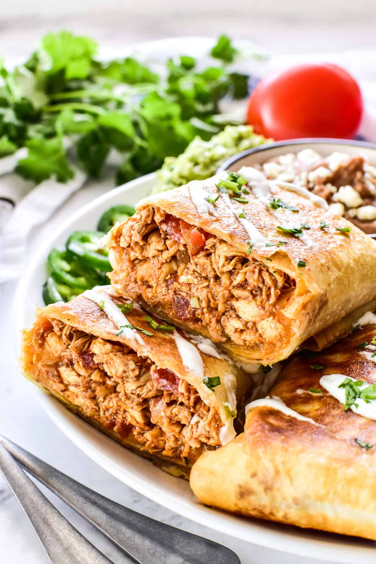 Chicken Chimichanga cut in half to show the inside