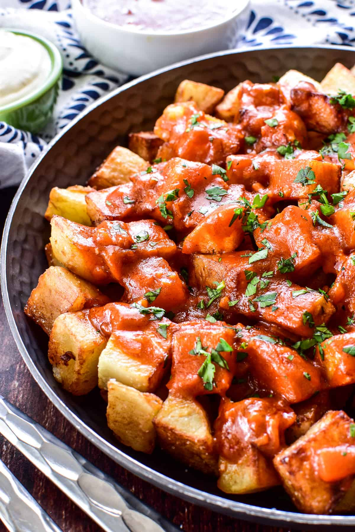 Close up of Patatas Bravas in a shallow bowl
