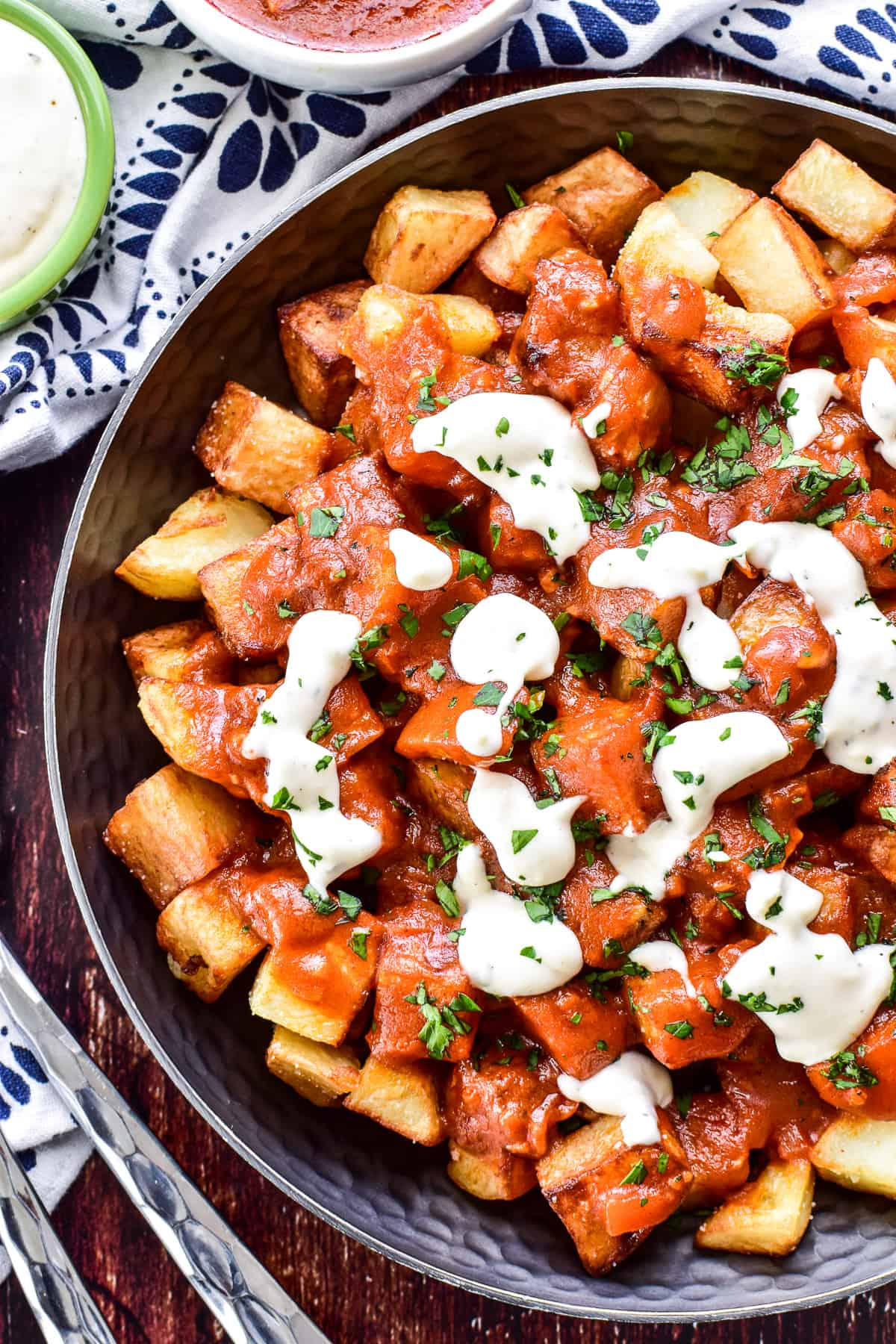 Overhead photo of Patatas Bravas with garlic aioli